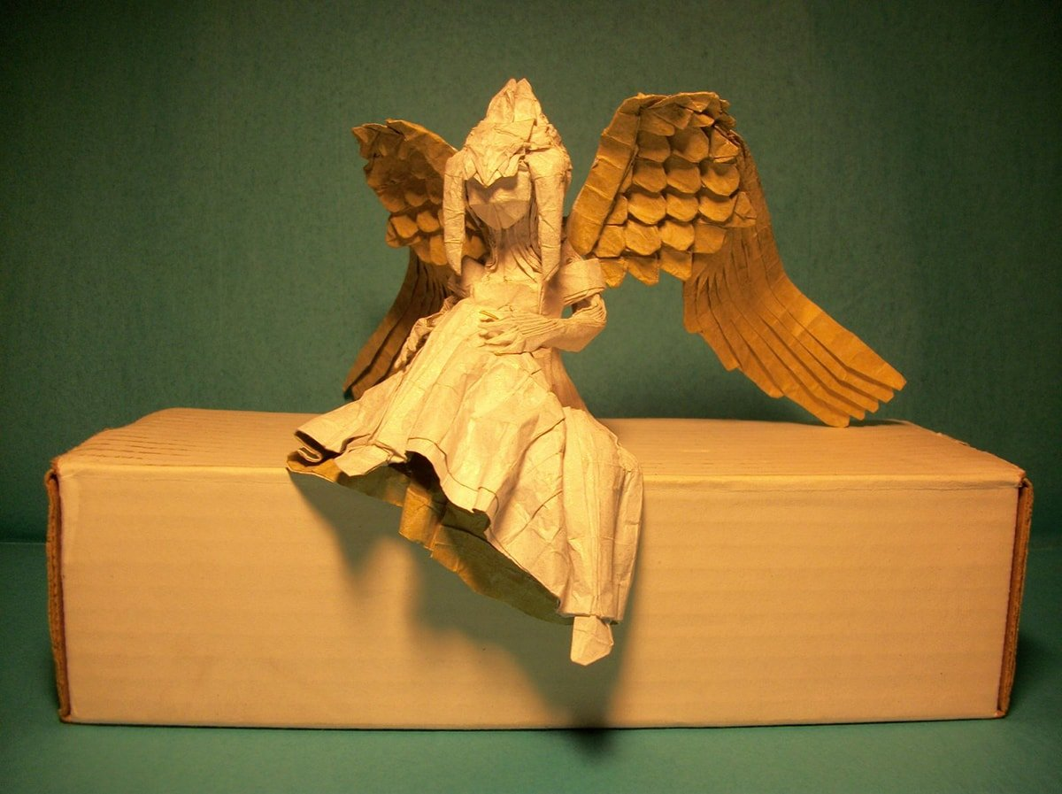 Paper Angel Sitting on Cardboard Box