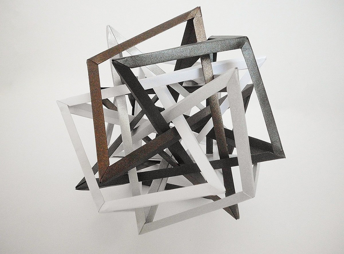 Four Interlocking Irregular Triaugmented Quasidiminished Hexahedra (Byriah Loper)